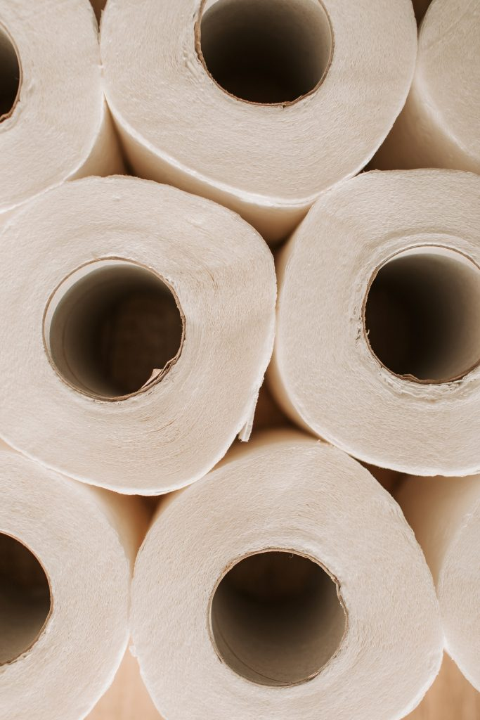 stack of toilet paper rolls in bathroom