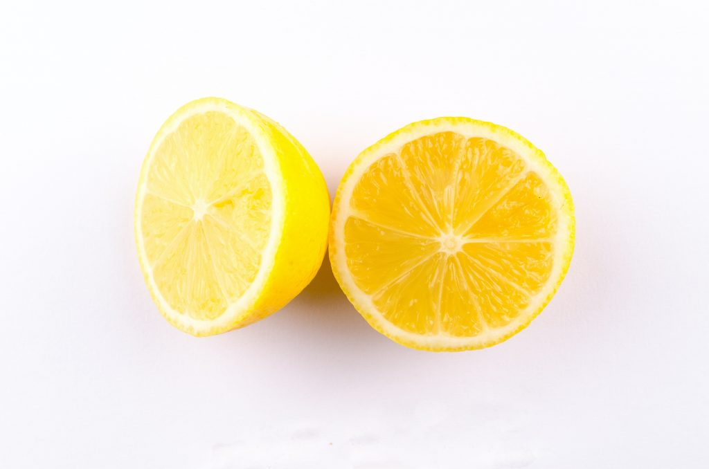 lemon cut in half that you can use to clean the sink